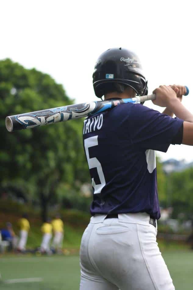 Baseball batter waits his turn to bat.