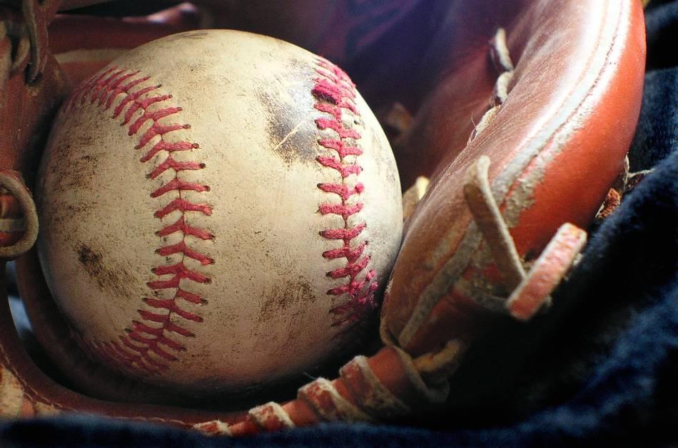 Baseball sitting in baseball glove.