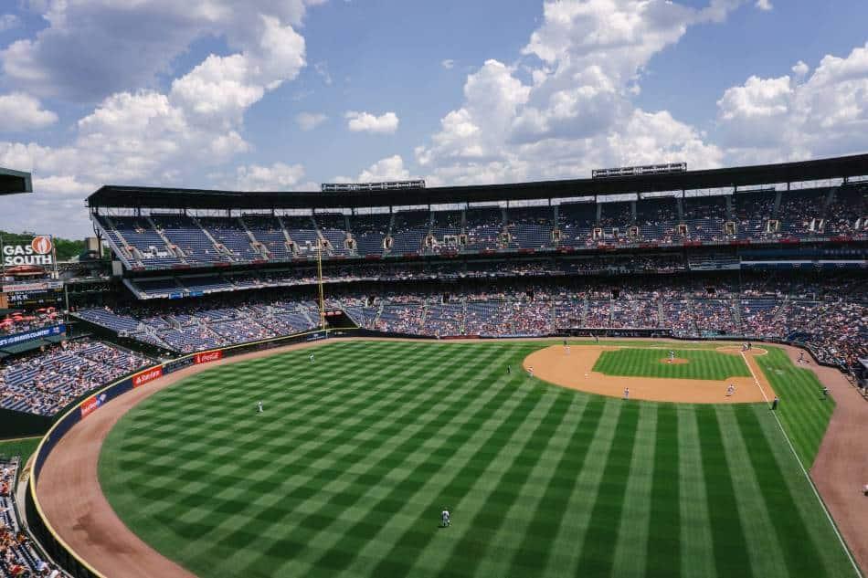 Baseball stadium on sunny day.