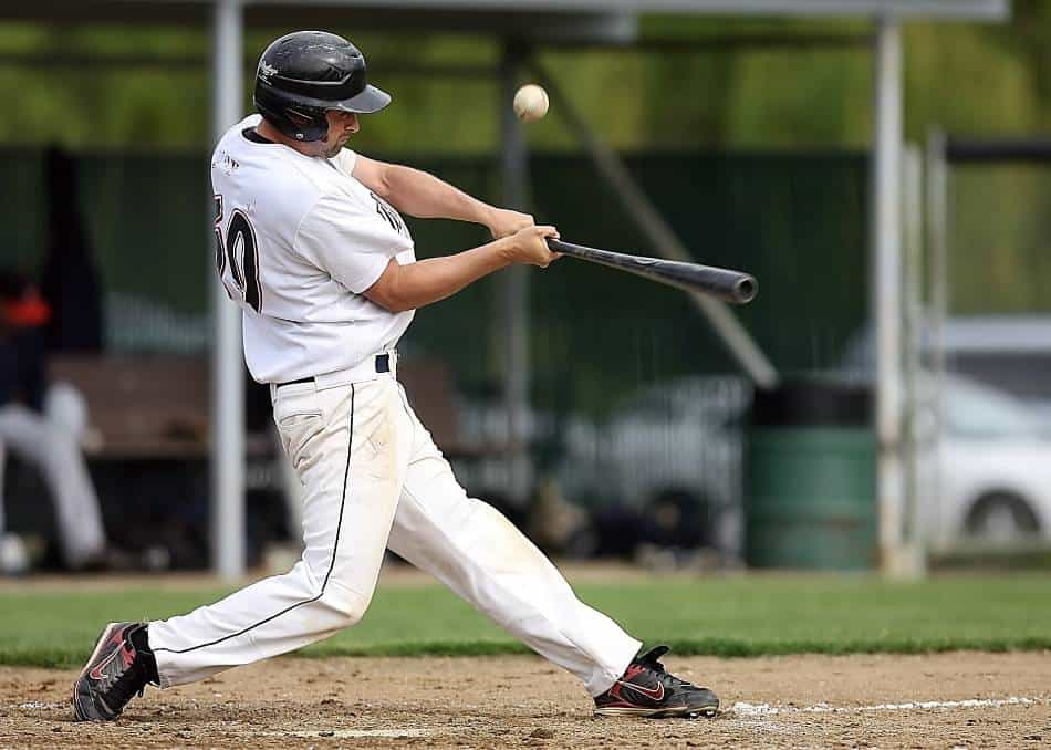 Baseball player fouls off pitch.
