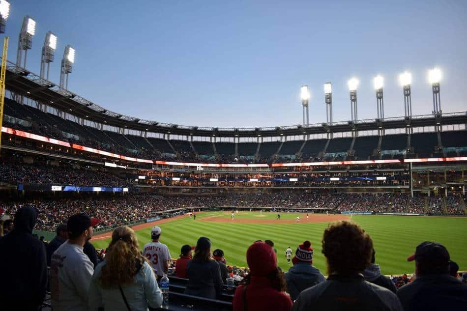 Baseball fans in stadium watching professional game.