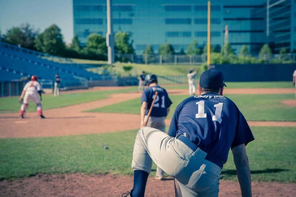 Baseball players wait their turn to bat.