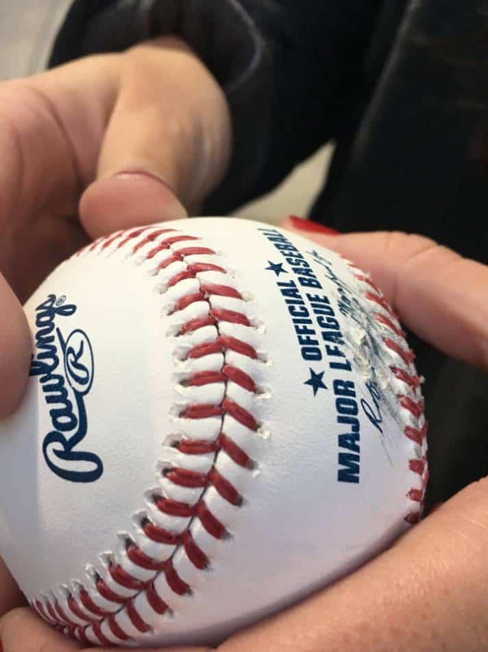 Man holds a baseball.