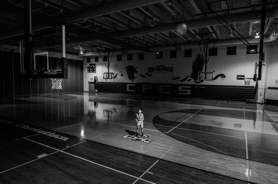 Youth basketball player shooting free throws.
