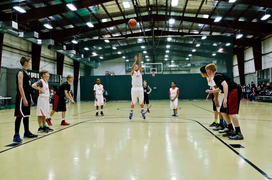 Youth basketball players line up for free throw.