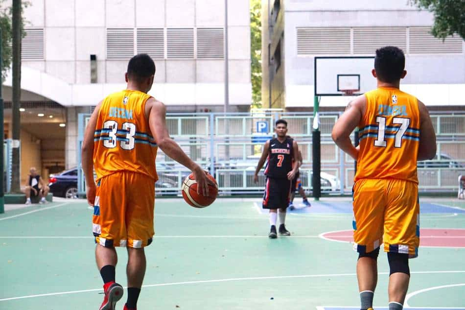 Basketball player dribbles the ball out of the backcourt.