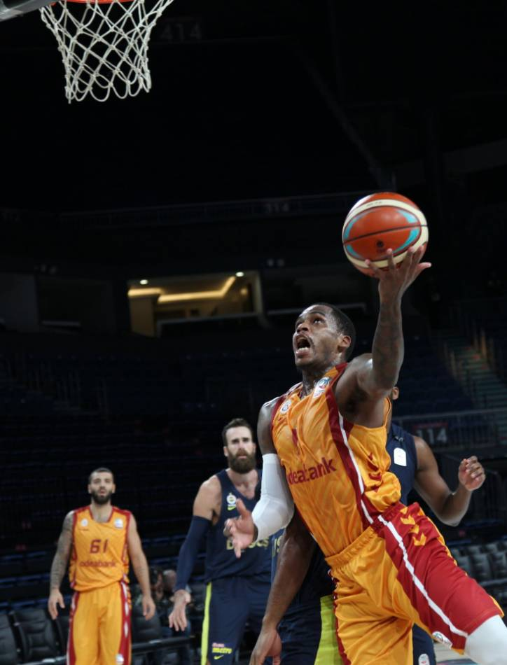 Basketball player going up for a layup.