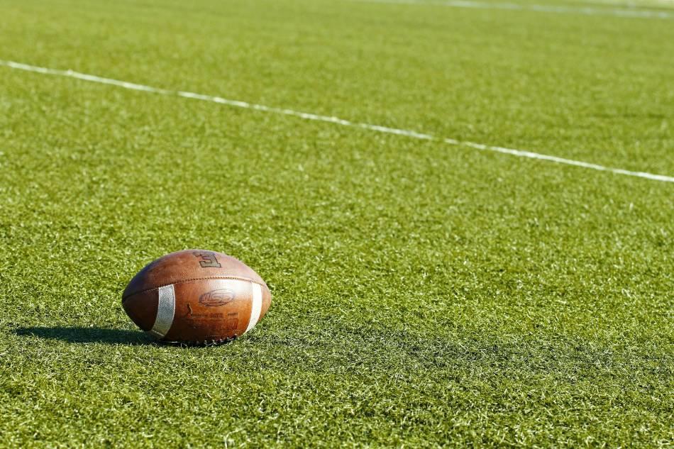 Football on football field.