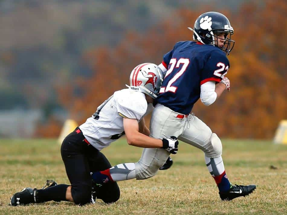 Youth football player tries to tackle quarterback.