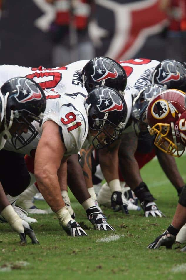 Offensive and defensive linemen ready for the quarterback to snap the ball.