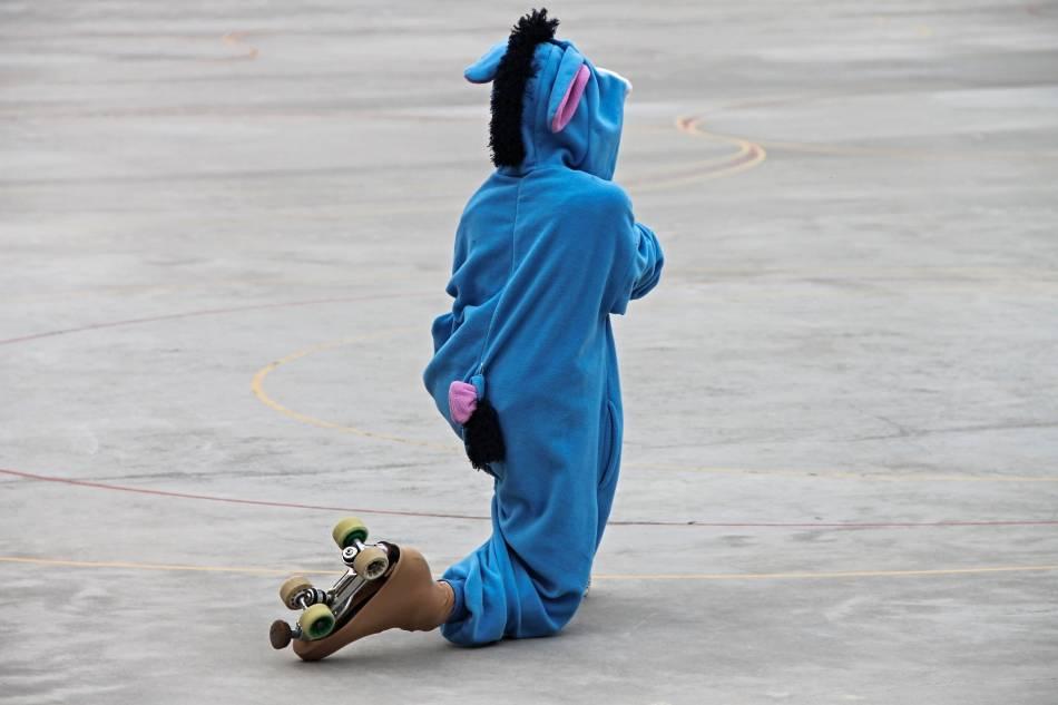 Kid roller-skating in Eeyore costume.