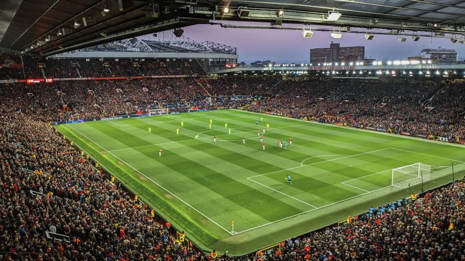 Soccer stadium full of fans get ready for game.