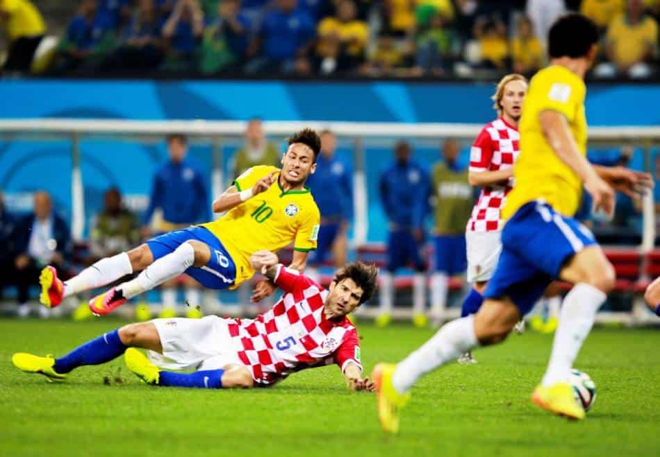 Croatian play slide tackles Brazilian Neymar.