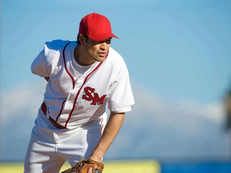 Baseball Pitcher looks home to figure out what pitch to throw.
