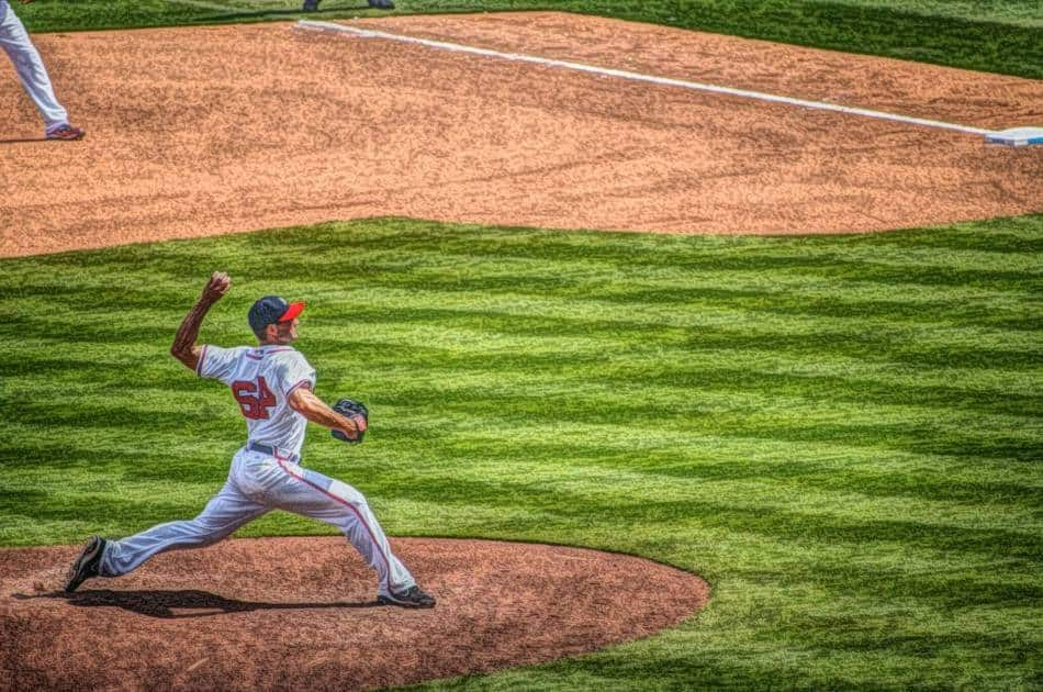 Left-handed baseball pitcher throwing a pitch.