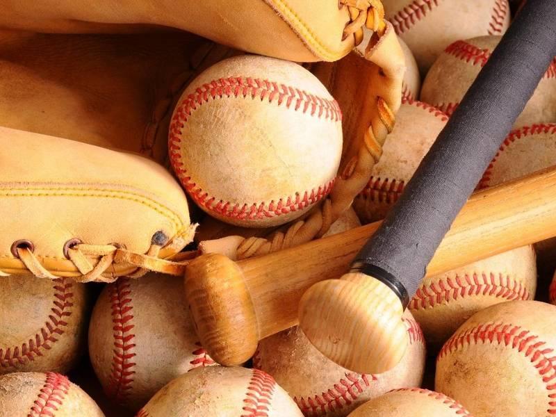 Baseballs, glove and baseball bats.