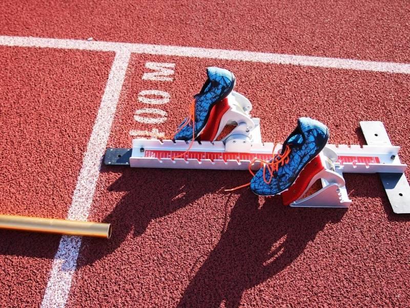 Track spikes on runner blocks.