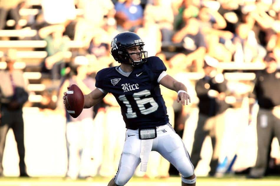 College football quarterback rears back to throw the ball.