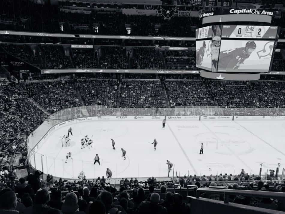 Black and white photo of professional hockey game.