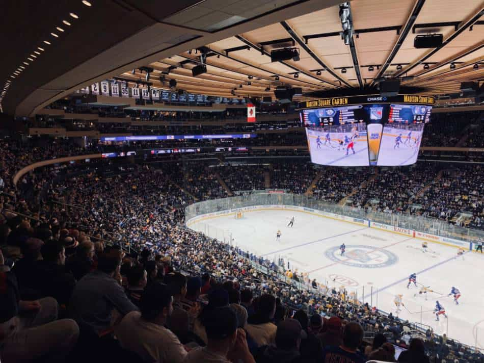 Hockey fans look on during an NHL game.