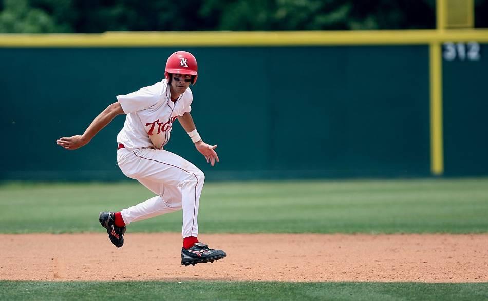 Baseball runner in between the bases as he looks home.