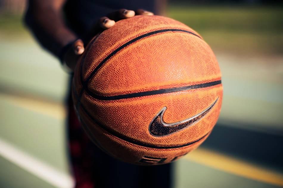 Man palming a basketball.