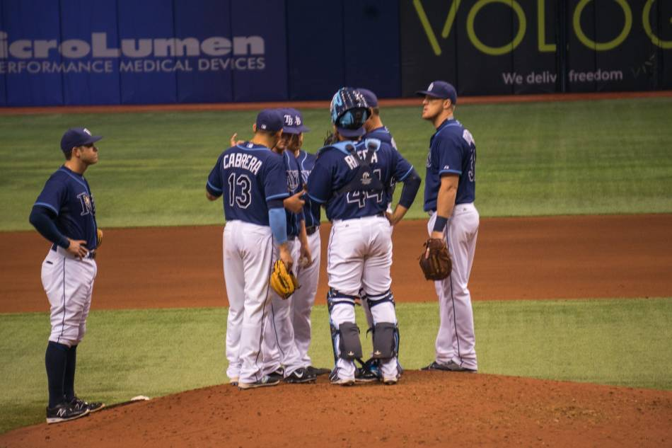 The Tampa Bay Rays meet at the pitcher's mound.