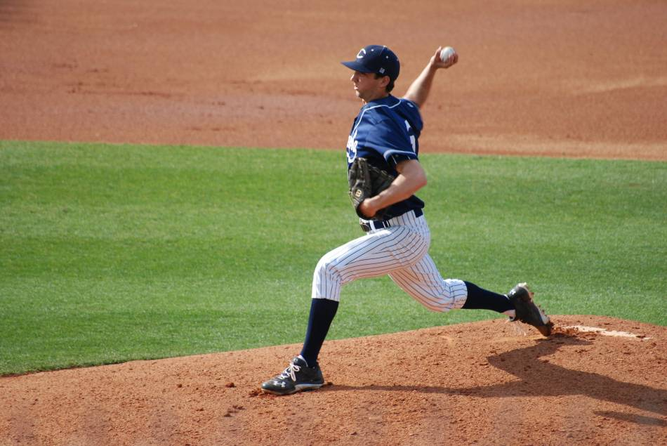 Right-handed baseball player throws a pitch.