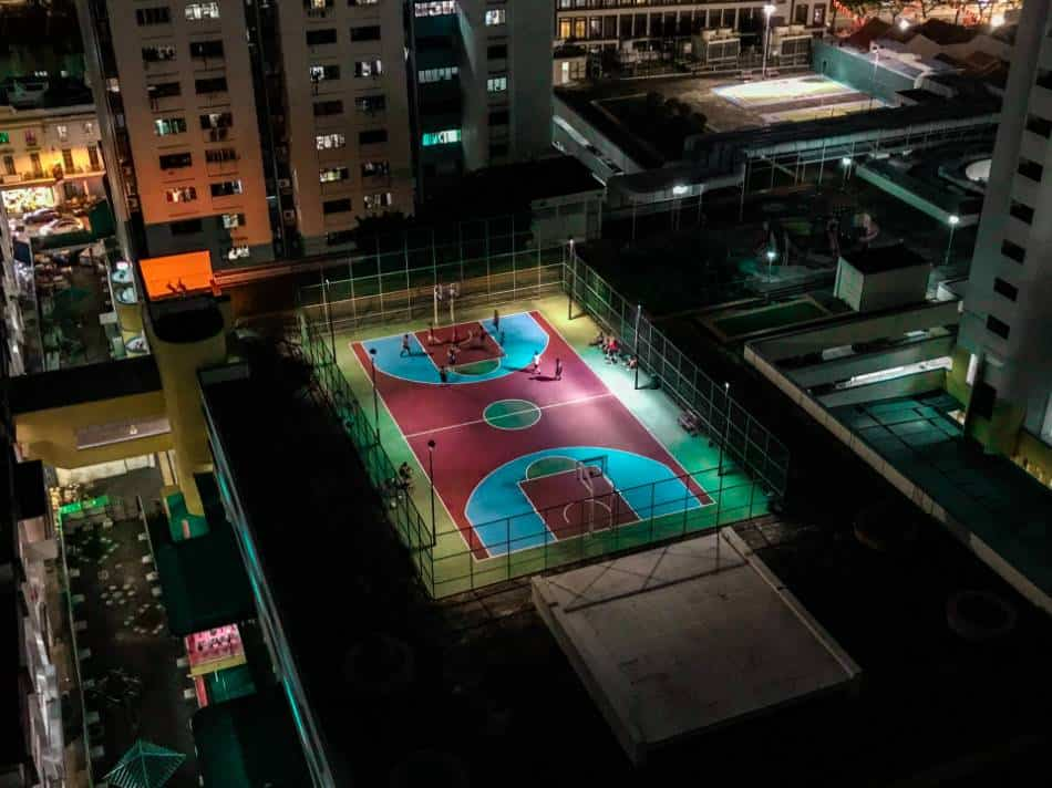 Outdoor red, green, and blue basketball court.