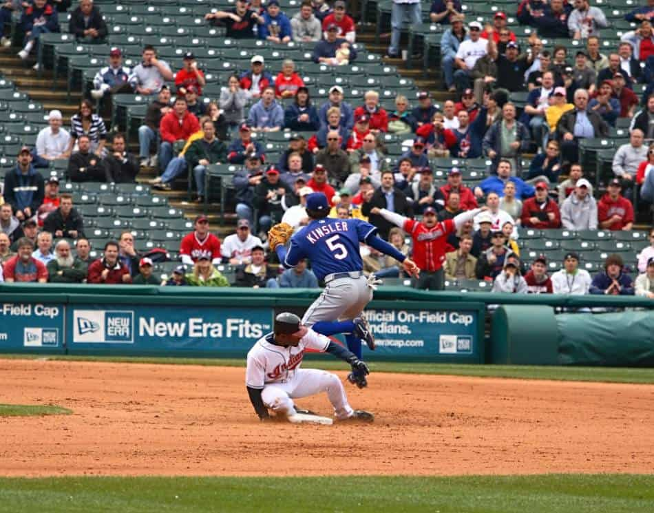 A Cleveland Indians player slides into second base.