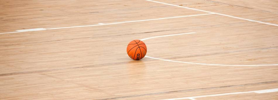 Basketball lying in the key on a basketball court.