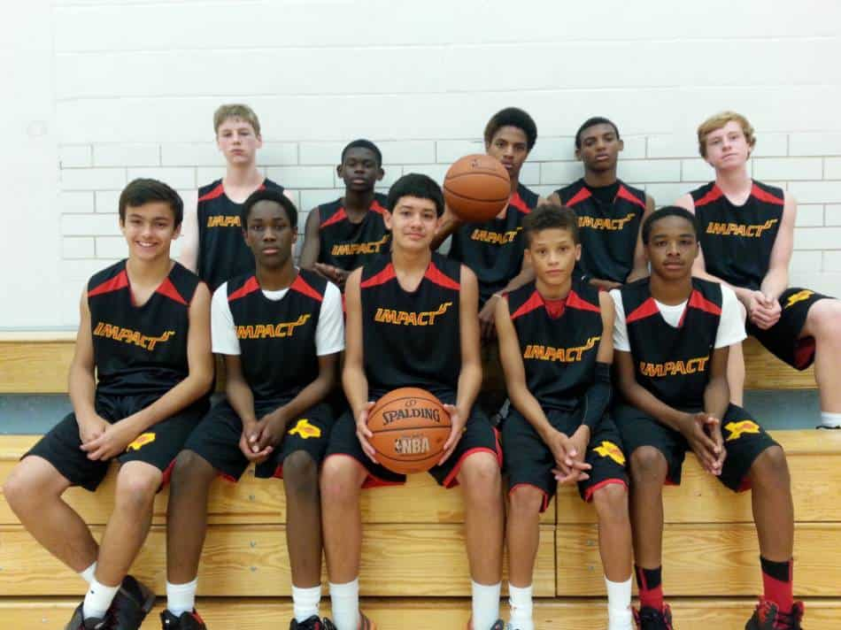 Youth basketball team posing for the camera.