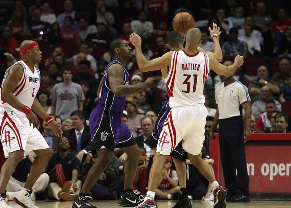 Sacramento Kings and Houston Rockets players battle for the ball.