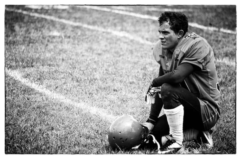 Black and white photo of a football player.