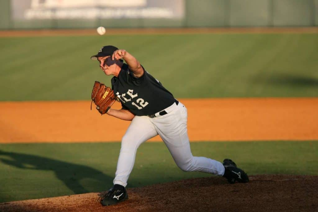 A Rice baseball pitcher throws the ball home.
