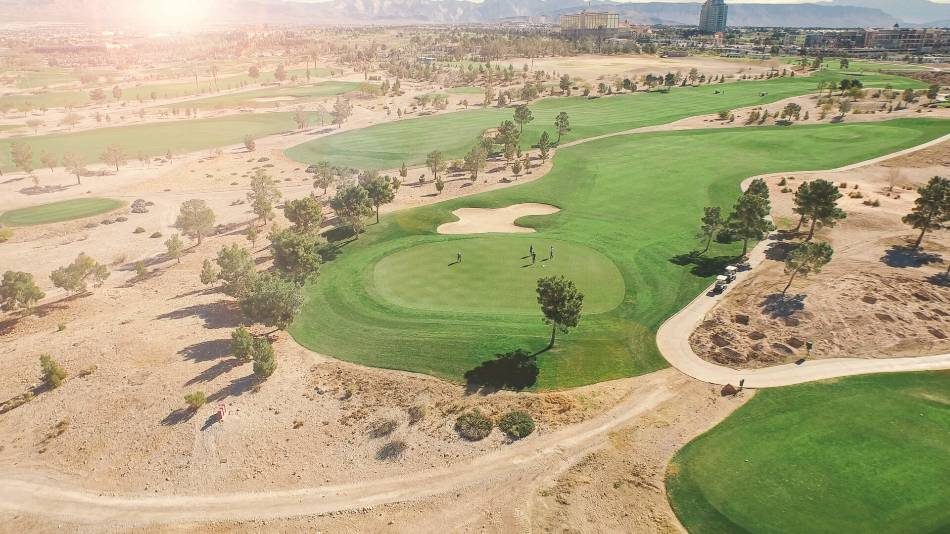 Aerial view of a golf course in the desert.