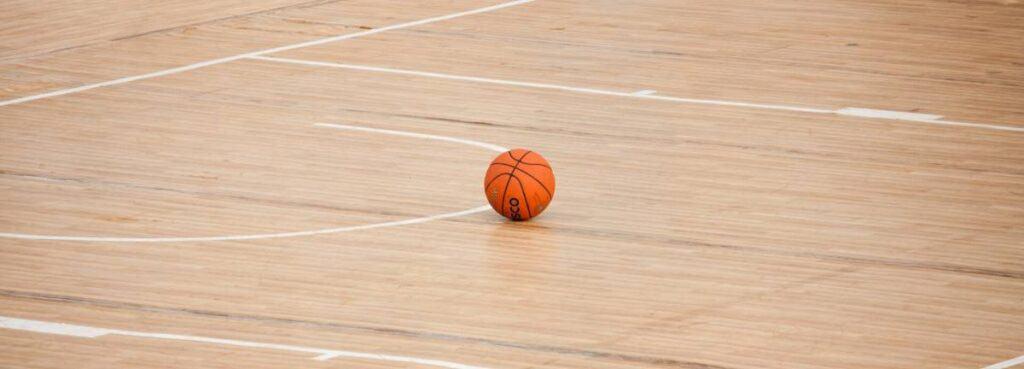 Basketball lying on the court during NBA halftime.