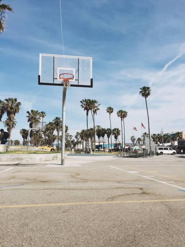 Outdoor basketball court near the beach.