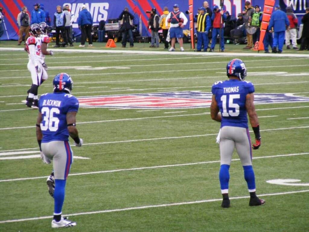 Two New York Giants players line up for a kickoff.