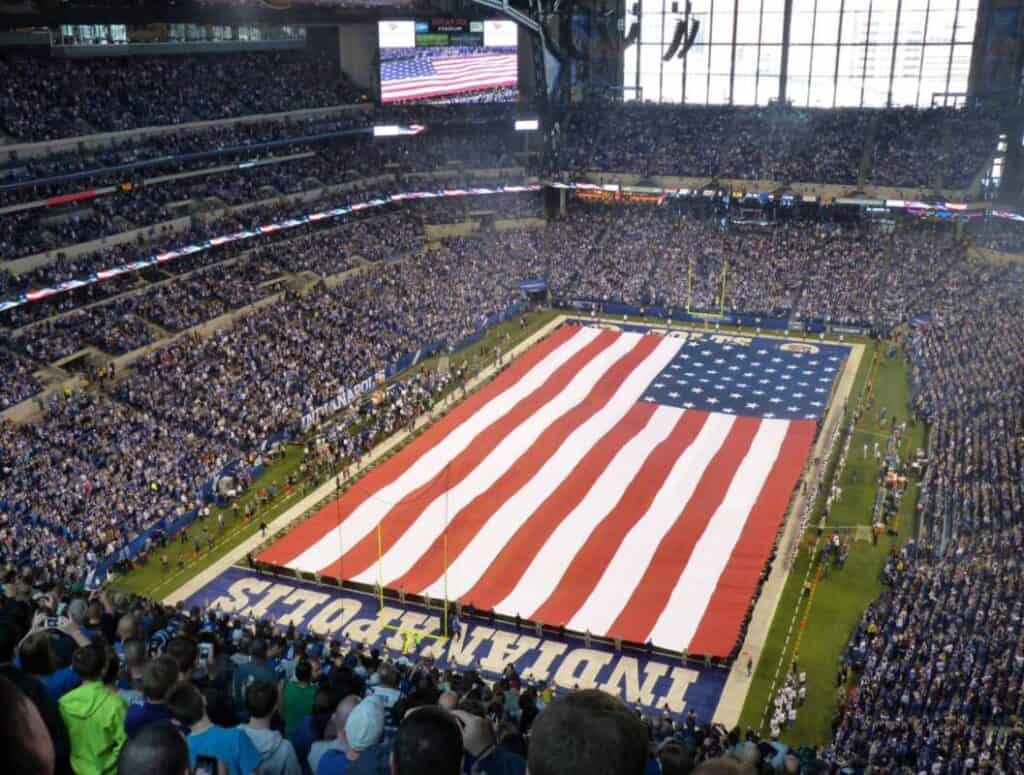 A gigantic American Flag covers the Indianapolis Colts' field during the National Anthem.