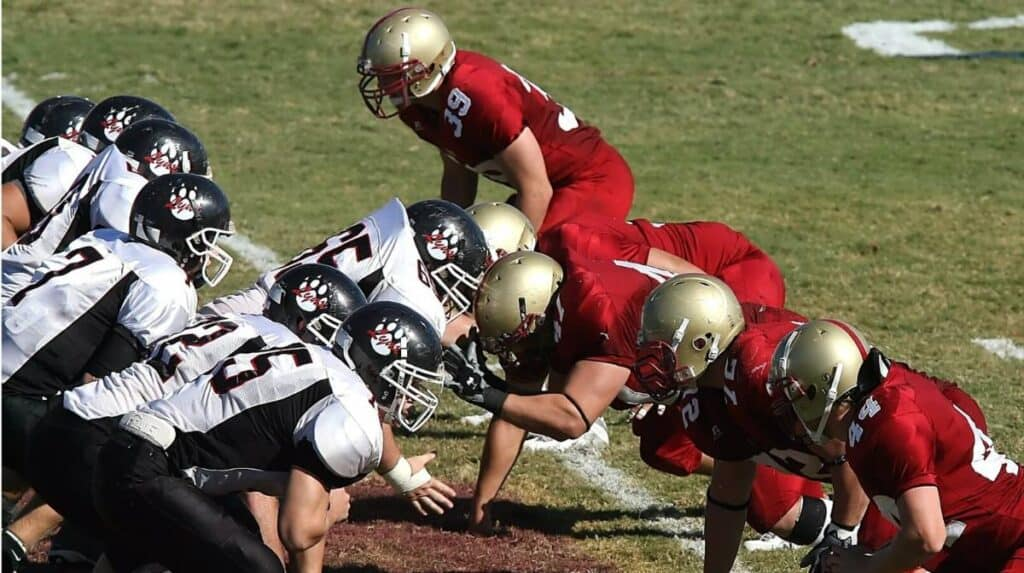 The nose tackle gets ready to rush the quarterback.