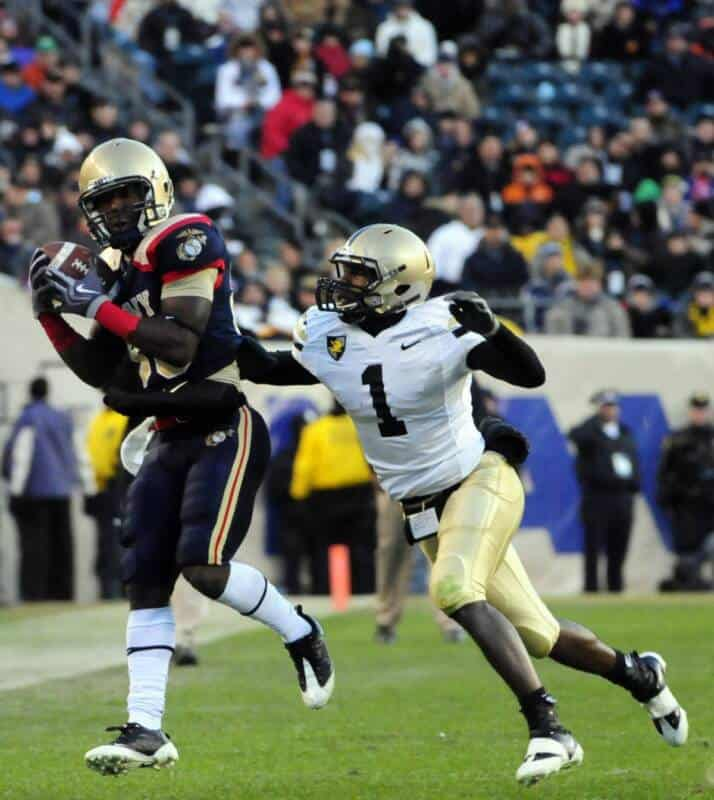 A safety tries to dislodge the ball from a receiver.