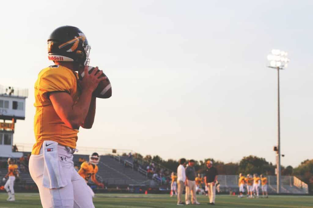 A high school QB warms up before his game.