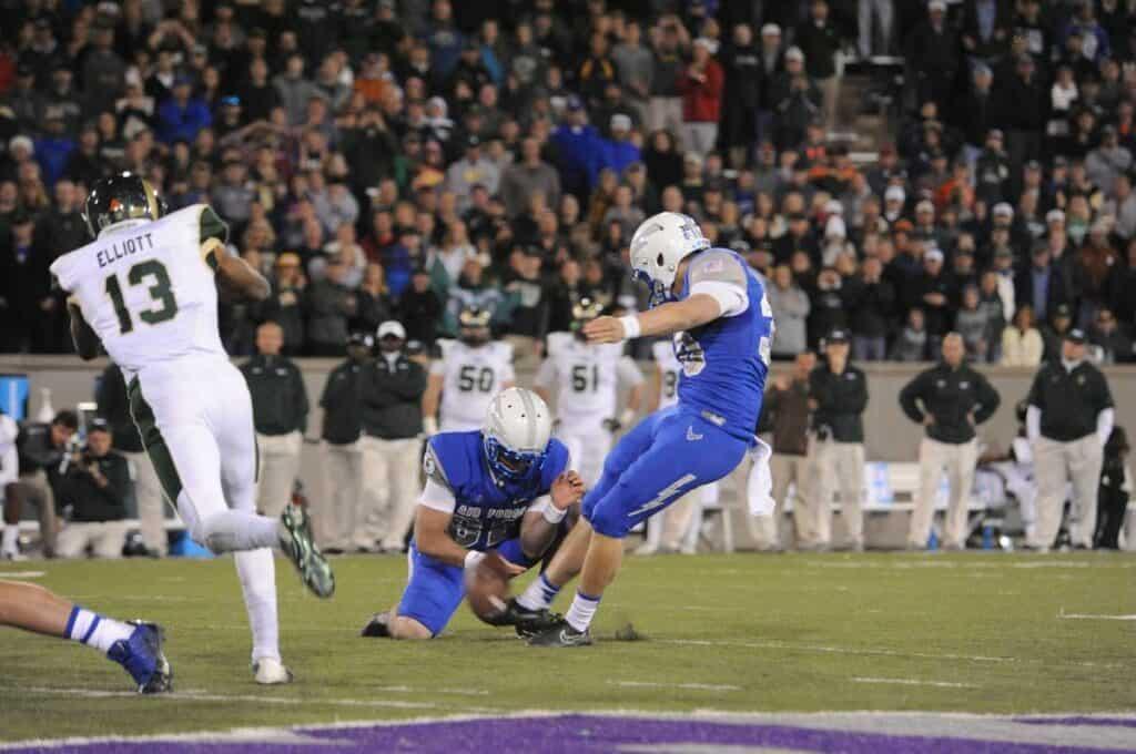 Air force kicker attempts a field goal.