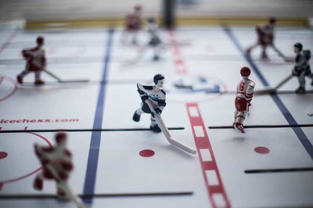 A bubble hockey player near the red line.