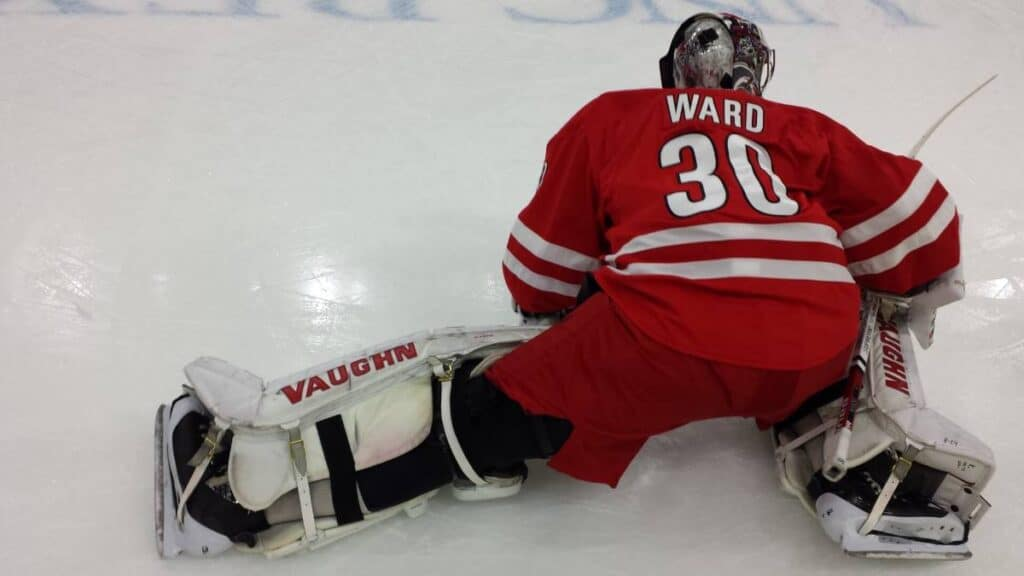 NHL goalie stretches out before the game.