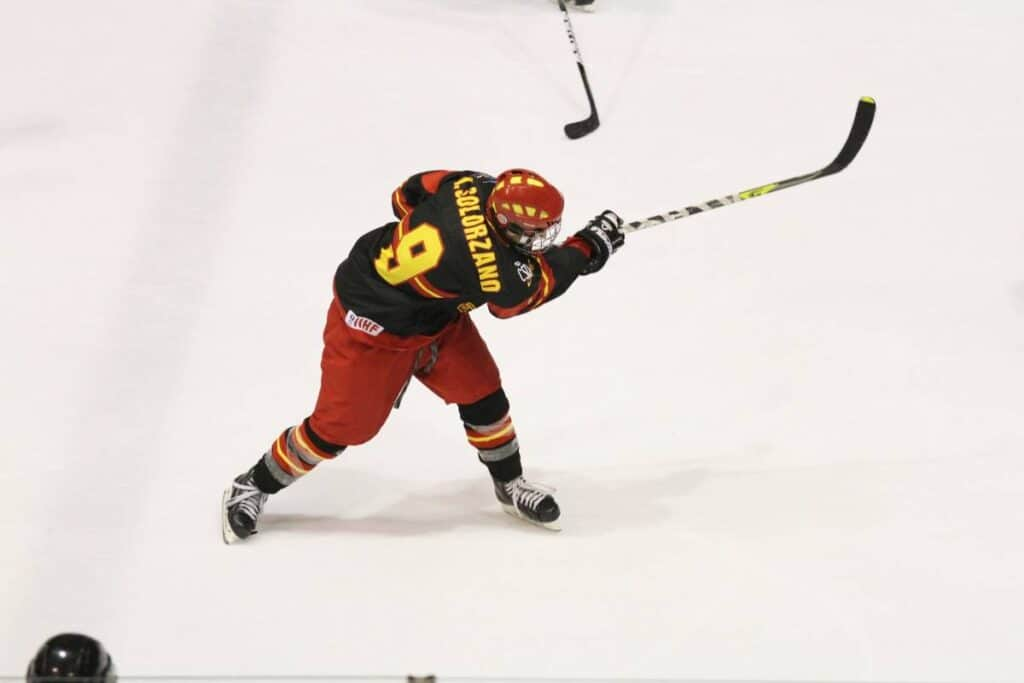 A defenseman takes a slapshot from the blue line.