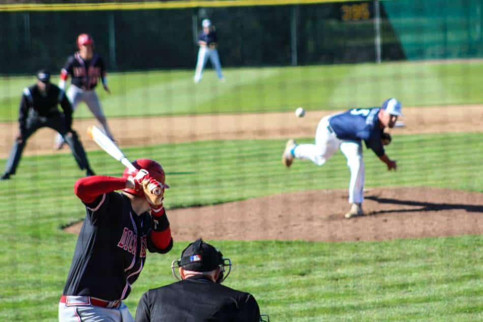 A baseball pitcher throws a pitch.