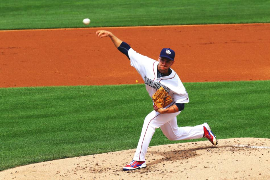 A pitcher throws the ball home.