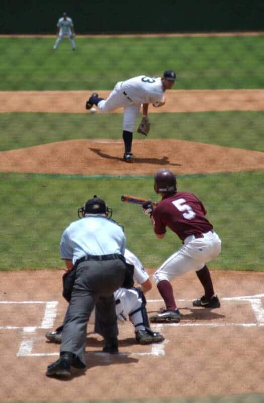 The batter shows bunt during the incoming pitch.
